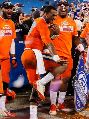 Quarterback Deshaun Watson of the Clemson Tigers strikes the Heisman pose with the trophy from the ACC Championship.