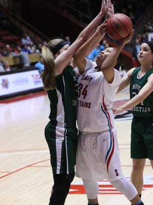 Shiprock's Shontai Grey goes up for a shot against Hope Christian's Alivia Lewis during their 4A state championship game on Friday at The Pit in Albuquerque.