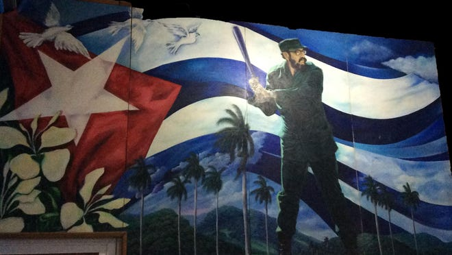 While in Cuba for 21 days in February, negotiating with officials on behalf of her Fort Myers-based, Carrera Sports baseball bat company, owner Barbara Rodriguez snapped this photo of a mural of a young Fidel Castro painted against the backdrop of a Cuban flag.