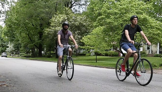 Greg Holman, left, and Shaun Fossett, of Springfield Bicycle Tours, ride down Pickwick Avenue on Saturday, May 21, 2017.