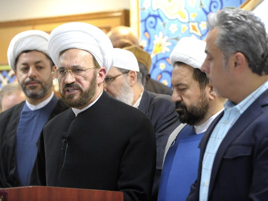 Imam Mohammad Ali Elahi, second from left, spiritual leader of the Islamic House of Wisdom, addresses the media during a press conference Wednesday.