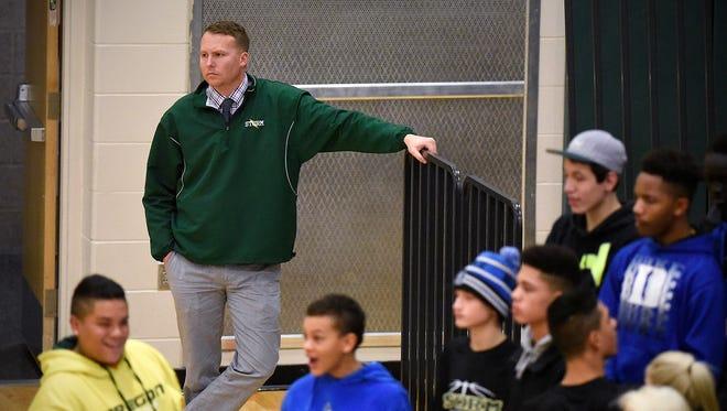 Sauk Rapids activities director Luke Lutterman watches the action during the first half of a Thursday, Dec. 17, 2015, basketball game at Sauk Rapids-Rice High School.