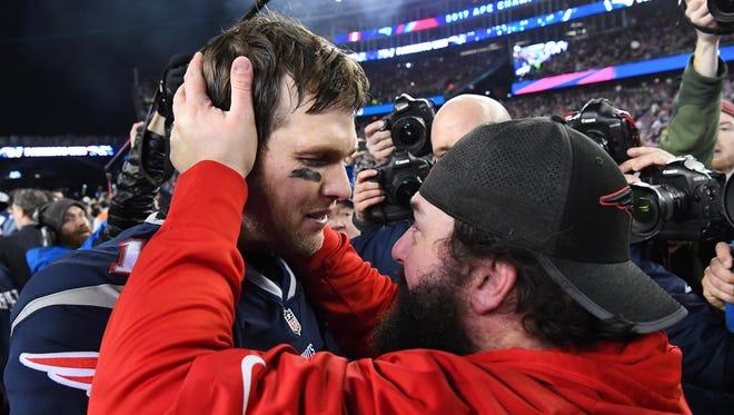 Jan 21, 2018; Foxborough, MA, USA; Patriots quarterback Tom Brady greets defensive coordinator Matt Patricia after defeating the Jaguars in the AFC Championship Game at Gillette Stadium.
