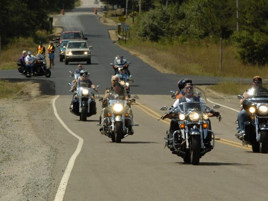 A group of motorcycles lead the way in the 100-mile