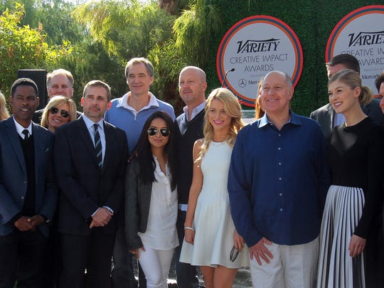 Chris Rock (front row, left), Steve Carell (front row, second from left), Rosamund Pike (front row, third from right), Rob Marshall (front row, second from right), and Richard Linklater (front row, right) pose in a large group photo during the Variety Creative Impact Awards brunch on Sunday, January 4, 2015 at the Parker Palm Springs.