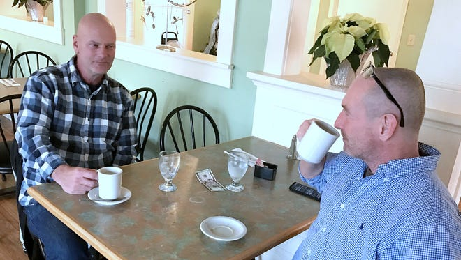 Gary Dunbar, left, and Thomas Brockway, both of Elmira, savor a cup of coffee after lunch Tuesday at the Pepper Pot Cafe in Elmira.