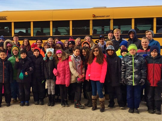 The St. Mary's Springs Academy JOOI Club and students from Parkside Elementary School recently participated on a dog sledding field trip to The Siberian Outpost in Malone. Students from both schools have been getting to know each other throughout the year by sending letters back and forth. This pen pal project has been a yearly project for the past three years, and it is always celebrated with a dog sledding experience. Pictured are SMSA and Mrs. Krueger's, Mrs. Bal's and Mr. Schuh's fifth-grade students on the field trip.