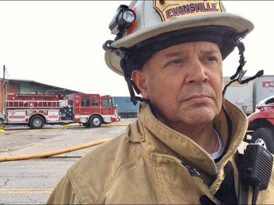 Evansville Fire Chief Mike Connelly describes morning fire at Eastside trucking company.