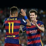 FC Barcelona's Lionel Messi, left, celebrates after scoring with teammate Neymar during a Spanish La Liga soccer match against Levante at the Camp Nou stadium in Barcelona, Spain, Sunday, Sept. 20, 2015.