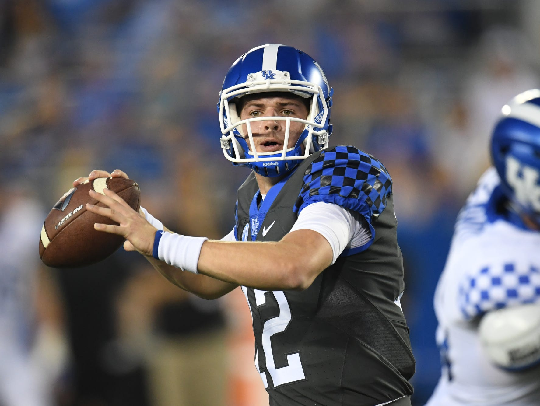 UK QB Gunnar Hoak passes during the University of Kentucky football Blue-White spring game in Lexington, KY on Friday, April 14, 2017.