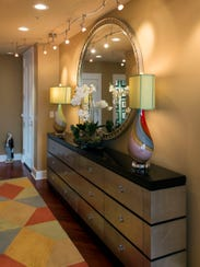 This foyer piece merges two cabinets into one. The