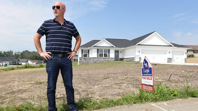 Realtor Dan Robison talks about a recently completed home in the Oakwood North subdivision north of Zanesville. The house was on the market one day before going into contract.