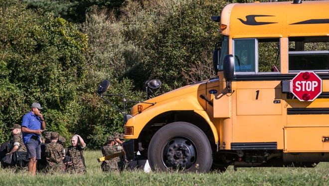 Five students were injured on Monday afternoon when a truck struck a school bus in Glasgow.