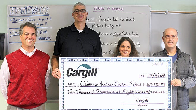 Cargill Salt recently awarded the Odessa-Montour School District a grant for new science  equipment. From left, high school Principal Skip McCarty, Cargill plant manager Keith Klug, science teacher Laurel Strobel and Cargill Cares Committee Chairman Jerry Dunlavey.