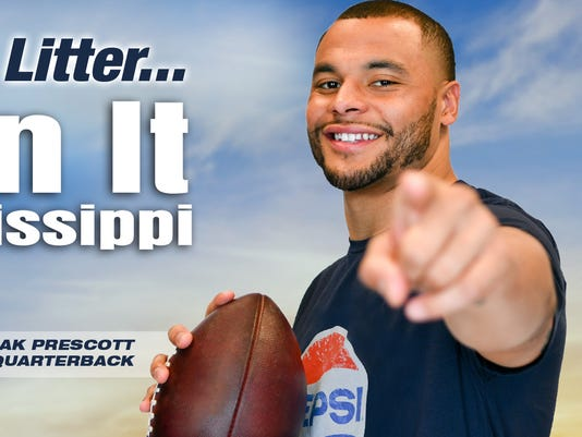 636595909594172276-dak-smiling-with-ball-pepsi-shirt.jpg