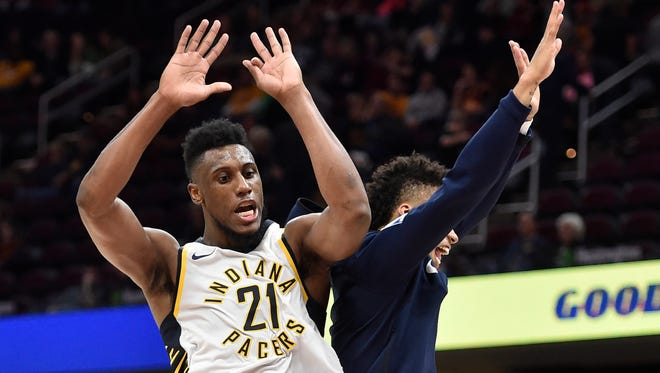 Indiana Pacers forward Thaddeus Young (21) celebrates in the fourth quarter against the Cleveland Cavaliers at Quicken Loans Arena.