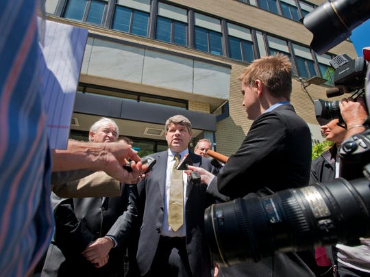 U.S. Attorney for Vermont Tristram Coffin, center, and state Attorney General Bill Sorrell, left, speak to reporters Tuesday after Michael Jacques was sentenced for the 2008 murder of Brooke Bennett.