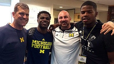 Defensive back Jabrill Peppers, recruiting operations assistant Chris Partridge and recruit Ron Johnson pose for a photo in Ann Arbor.