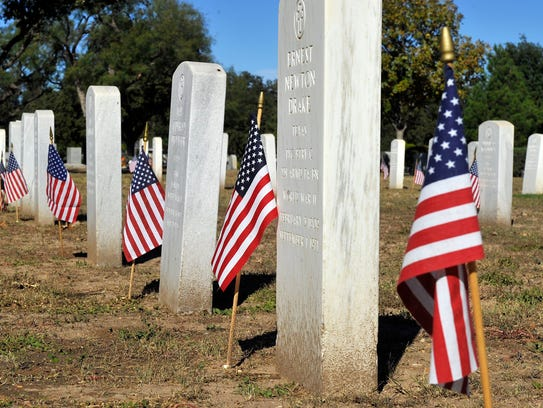 Volunteers placed American flags on the graves of the