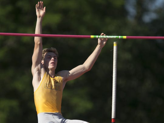 Ryan Lipe of Carmel, clears 16 feet during the pole vault, IHSAA Boys Track and Field State Finals on Friday in Bloomington. He also ran 100 meters, the 400-meter relay and   1,600-meter relay.
