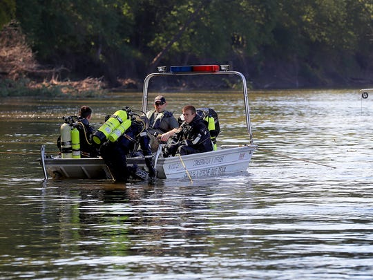Indiana conservation officers and dive team members