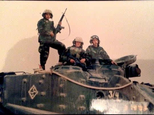 Sgt. Joel Ruiz (standing), then LCpl. Daniel Dineen (now a lieutenant), and Cpl. Kelly Mercer (right).