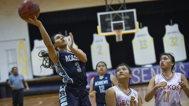 The Academy of Our Lady of Guam Cougars visited the George Washington Geckos in an Independent Interscholastic Athletic Association of Guam Girls' Basketball League match on Nov. 28.