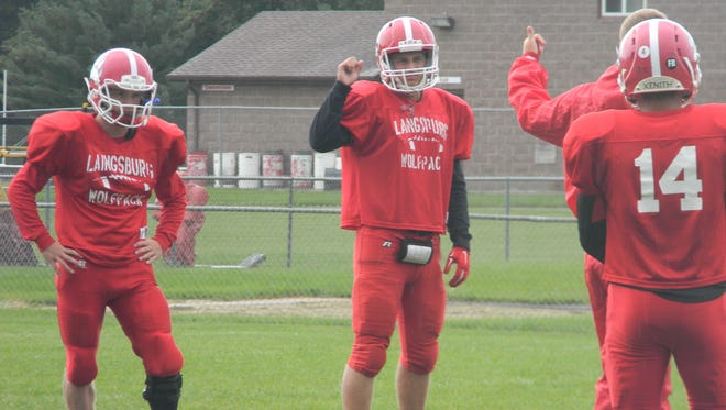 Laingsburg senior Lucas Fraidenburg, left, and teammates listen to instructions prior to a drill during Wednesday's practice. Fraidenburg, who missed his junior season due to an ACL injury, has been a key contributor in Laingsburg's 5-0 start.