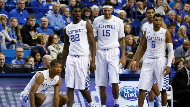Kentucky Wildcats guard Aaron Harrison (2) guard forward Alex Poythress (22) forward Willie Cauley-Stein (15) guard Andrew Harrison (5) enter the game after a time out during the game against the Grand Canyon Antelopes at Rupp Arena.