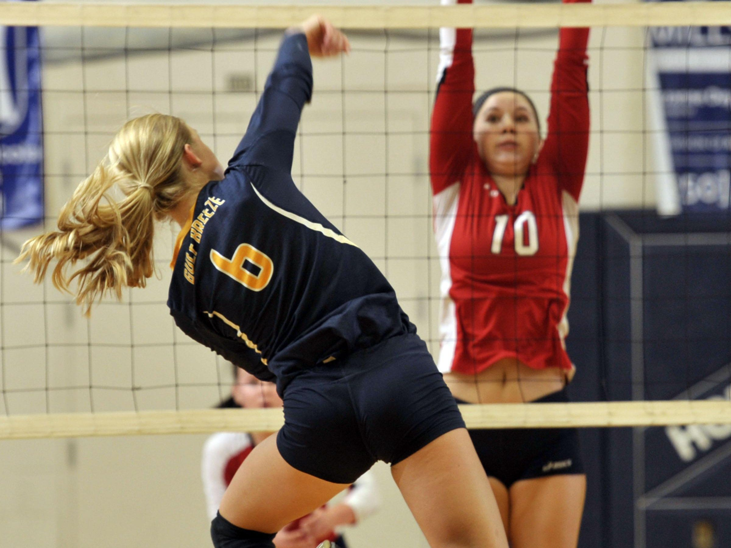 Olivia Hepworth of the Gulf Breeze Dolphins drives the ball past defending Ft. Walton Beach Vikings player No. 10, Savannah Bailey, during their region 1-6A quarterfinal game Wednesday night at Gulf Breeze High. The Dolphins won in four games.