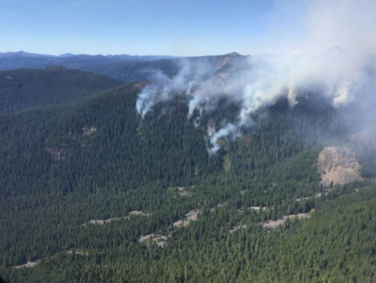 Whitewater Fire begins spilling down steep cliffs into