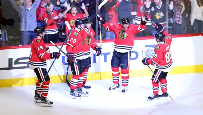 Chicago Blackhawks right wing Marian Hossa (81) celebrates after scoring the game-winning goal against the New Jersey Devils in overtime at United Center on Dec. 1