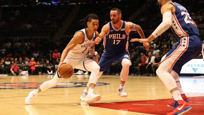 Brooklyn Nets guard Jeremy Lin (7) dribbles the ball as Philadelphia 76ers guard JJ Redick (17) defends during the third quarter at Nassau Veterans Memorial Coliseum.
