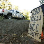 A sign honoring those killed in a shooting at Umpqua Community College, on Oct. 2, 2015, in Roseburg, Ore.