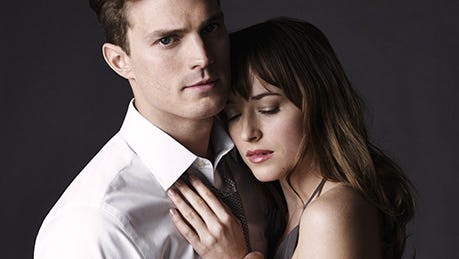 """Jamie Dornan and Dakota Johnson star in """"Fifty Shades of Grey,"""" coming out Feb. 14, 2015."""