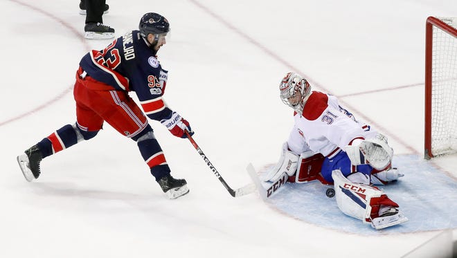 Montreal Canadiens goalie Carey Price (31) blocks a shot by New York Rangers center Mika Zibanejad (93) during the shootout in Thursday's game.