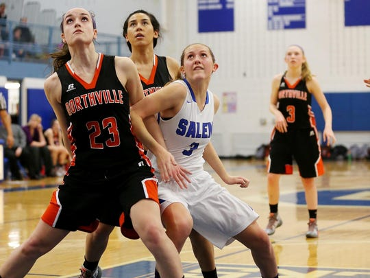 Tracking the basketball under the rim are Northville's Lindsay Rathsburg (No. 23) and Salem's Leah Moss (No. 3).