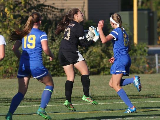 Arlington goalkeeper Becky Gold makes a save against