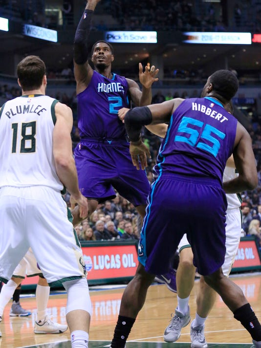 Charlotte Hornets forward Marvin Williams, center, goes up for a basket against the Milwaukee Bucks during the first half of a NBA basketball game Wednesday, Oct. 26, 2016, in Milwaukee. (AP Photo/Darren Hauck)