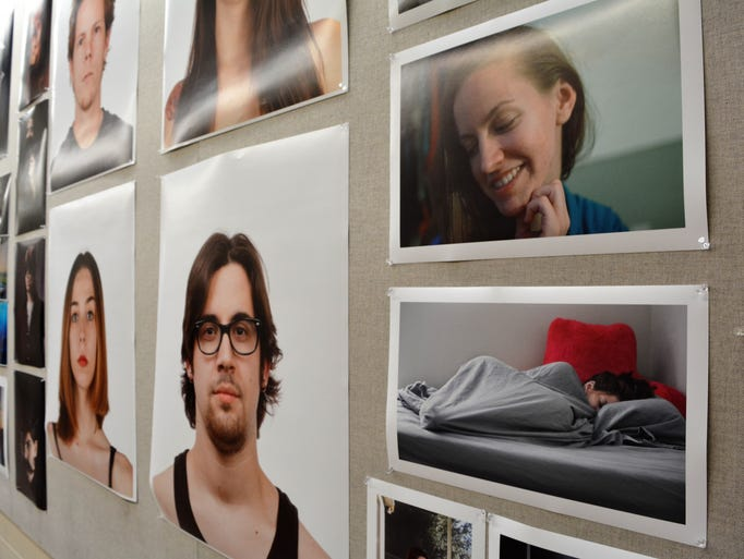 Portraits along with other photographs taken be students