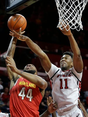 Rutgers forward Kadeem Jack tries to block a shot by Maryland's Dez Wells during the first half. Wells had 20 points and 10 rebounds.