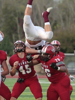Lang Evans of Turpin goes up and over in an effort to block the Kings field goal.