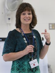 Math teacher Kristina Vantassel instructs parents and