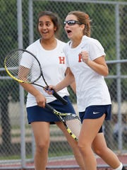 Harrison's Kensington Eiler, foreground, right, and Sukhi Kaur celebrate a point against Rileigh McTagertt and Olivia Fee of Lafayette Jeff in the No. 1 doubles match in the first round of the girls tennis sectional Wednesday, May 18, 2016, at Cumberland Elementary School courts. Harrison sweep Lafayette Jeff 5-0.