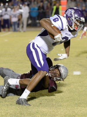 Milan's Anthony Ballard is tripped by Liberty Tech's Stephun Bush during their game. Liberty defeated Milan, 25-9.
