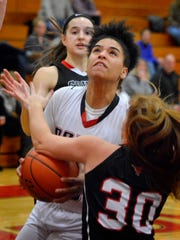 Dover's Rajah Fink is fouled on her way to the basket by Lily Soullaird of Southwestern, Monday, Feb. 5, 2018. John A. Pavoncello photo