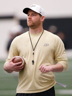 Quarterbacks coach and co-offensive coordinator Brian Brohm watches as the quarterbacks run drills during Purdue spring football practice Monday, April 2, 2018, inside the Mollenkopf Athletic Center.