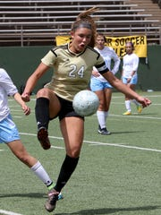 Rider's Keeley Ayala takes possession of the ball against