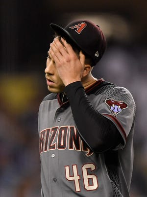 Arizona Diamondbacks starting pitcher Patrick Corbin wipes his face after the end of the fourth inning of the team's baseball game against the Los Angeles Dodgers on Wednesday, May 9, 2018, in Los Angeles.