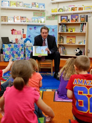 Governor Steve Bullock reads to pre-k students at Great Falls Public Schools Pre School in the Early Learning Center at Skyline Tuesday.